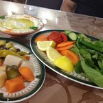 Humus... rich with olive oil and the salad and pickles and olives..