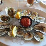 Raw clams and oysters.