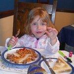 My daughter enjoying her breakfast sausage and bean circle