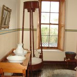 One of the first showers, House 4, Village Museum
