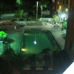 nighttime pool and jacuzzi