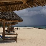 Hotel's sun shelters on the beach in front