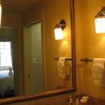 bathroom with pocket door in mirror