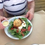 Crabcake on spinach salad