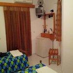 the tv, fridge and the main balcony - room 18