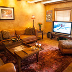 Guest Den - second level guest den features stone fireplace, large screen TV and mountain views
