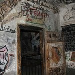 this cell was covered with paintings, messages and name for the cell