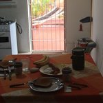 our breakfast with a partial view of the kitchen, dining and sitting room (couch behind the came