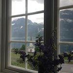 View from the living room onto the old stave church in Luster and the Feigenfossen waterfall