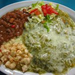 Chicken enchilada plate with green chili