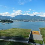View of the green roof of the Vancouver Convention Centre from a harbour-facing room