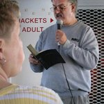 Rev. Erik Alsgaard from St. Ignace UMC reads a Bible passage as ferry approaches Mighty Mac.