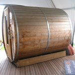Outdoor barrel sauna.