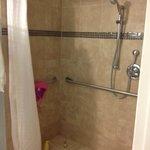 Nice tiled shower.