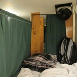 curtained bed, with overhead fan