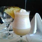 Mocktail - apple juice, pineapple juice, lime, and almond syrup