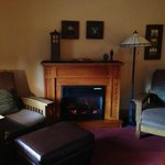 Room 206, view of fireplace and cozy seating area