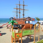 Pirate ship on beach, beware, slides are metal