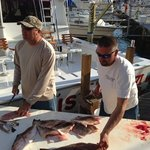Captain Eric & Tim cutting up our catch.