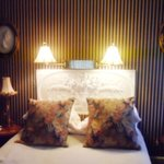 Bed with plaster headboard
