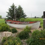 A cute boat outside the front entrance that fits with the nautical/outdoor theme of the property