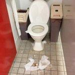 used tampon on toilet floor