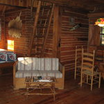 Woodsman cabin: living area and bed alcove
