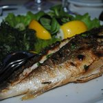 an excellent grilled dorade with spinach and potatoes