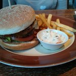 Chilli beefburger with skin-on fries and coleslaw.