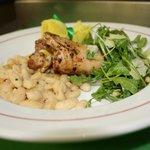 Chicken Paillard with Spanish white beans, arugula, pine nuts, parmesan cheese & infused garlic