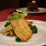 Our delicious dijon crusted lemon sole with sautéed sweet potatoes, fennel, and spinach