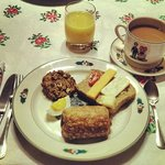 Homemade bread, chocolate croissants, eggs and a breakfast cookie along with adorable flatwear