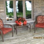 Chairs for the Lakefront suite outside the window overlooking the water