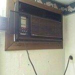 Air Conditioner in room/tacky wallpaper