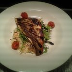 crispy pan fried seabass with a seafood risotto finished with crispy rocket salad and a drizzle