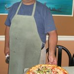John with a vegie pizza