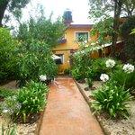 View of La Casa de Vida after walking through the gate. Gardens all around!