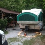 Site 26 not on river, but..near bath house separated  by privacy shrub, covered picnic table,  l