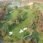 Fellow ballons over golf course