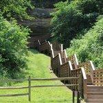 Steps leading to the cliff overhang with hieroglyphics. ©Tamara Hughbanks
