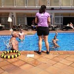enjoying waterball with other guests in the swimming pool
