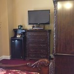 Antique wardrobe, dresser, and a nice TV, fridge, and coffee maker - king room