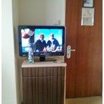 TV pequena e distante para se ver