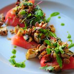 Grilled Watermelon with tofu ceviche topped with micro arugula greens.