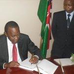 The President of Republic of Kenya H.E. Uhuru Kenyatta signing Hotel Belair's visitors book