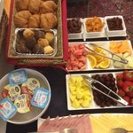 fresh fruit and muffins on the breakfast table