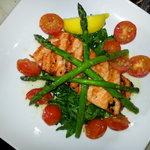 Grilled Scottish Salmon with roasted Asparagus & cherry tomatoes, set on a bed of fresh spinach.