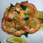 Parmesan Black Tiger Shrimp with a lemon & garlic butter, set on a bed of roasted potato and spi