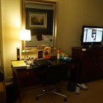 View of the desk and TV from the bed