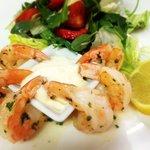 Garlic king prawns on green leaves salad and Aioli sauce
